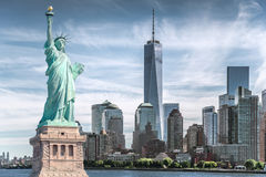 stock image of  the statue of liberty with world trade center background, landmarks of new york city