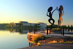 stock image of  statue at sombe k'e park and civic plaza with prince of wales northern heritage centre, yellowknife
