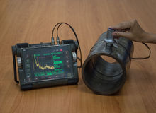 stock image of  steel pipe inspection by ultrasonic test for found internal defect
