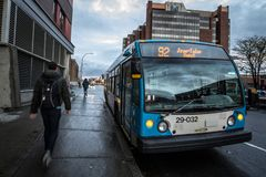 stock image of  stm logo on one of their urban buses in jean talon stop. also known as societe de transport de montreal
