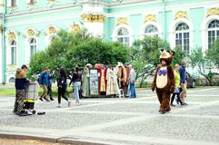 stock image of  street performers in costumes of cartoon characters entertain tourists in st. petersburg