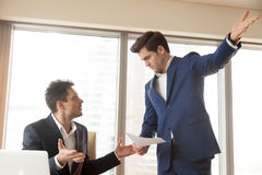 stock image of  strict boss firing incompetent employee for bad work at workplac