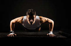 stock image of  strong man doing push-ups