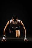 stock image of  strong man preparing to run