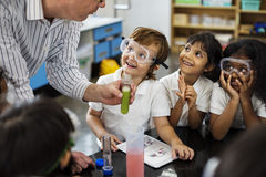 stock image of  students learning in science experiment laboratory class