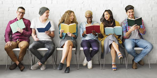 stock image of  students youth adult reading education knowledge concept
