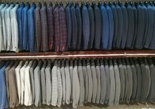 stock image of  suits for men in a shop