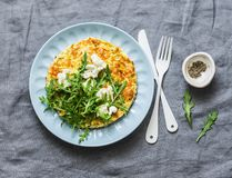 stock image of  summer squash frittata with goat cheese and arugula - delicious healthy diet food, breakfast, snack on a gray background