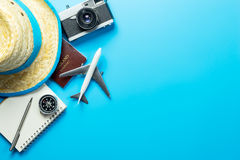 stock image of  summer travel blogger accesories on blue