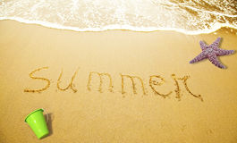 stock image of  summer written in sand
