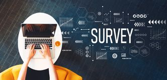 stock image of  survey with person using a laptop