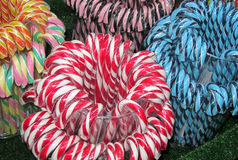 stock image of  sweetmeats. christmas fair. candy cane.