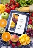 stock image of  tablet healthy diet fruit food app