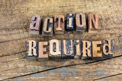 stock image of  take action required letterpress