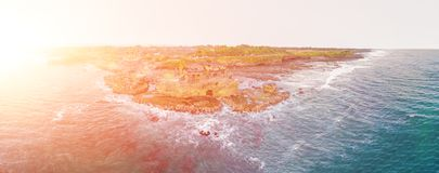 stock image of  tanah lot - temple in the ocean. bali, indonesia. photo from the drone. banner, long format
