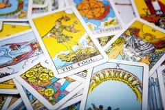 stock image of  tarot cards mystical background. senior card fool.