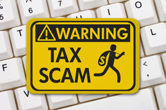 stock image of  tax scam warning sign