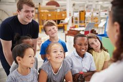 stock image of  teacher and kids having fun at a science centre