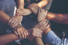 stock image of  team work concept : group of diverse hands together cross processing of young people in the nature