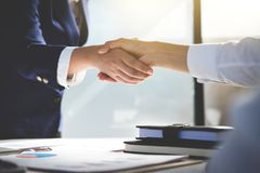 stock image of  teamwork process, image of business team greeting handshake. successful business people handshaking after good deal, success, dea