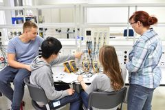 stock image of  technical vocational training in industry: young apprentices and