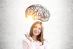 stock image of  teen girl in pink and a brain sketch