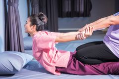 stock image of  thai massage by stretch back and hands