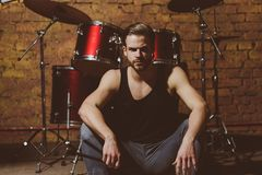 stock image of  theres music in the air. enjoying instrumental music. handsome man sit on stage at percussion instrument. man drummer