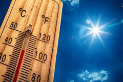 stock image of  thermometer sun sky 40 degres. hot summer day. high summer temperatures in degrees celsius and farenheit