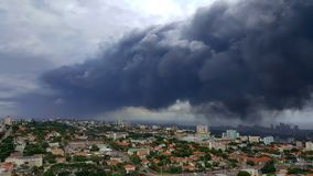 stock image of  thick dark grey pollution smog over the city of durban.