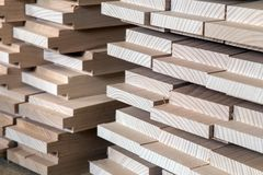 stock image of  timber, wood building material for background and texture. details wood production spike. composition wood products