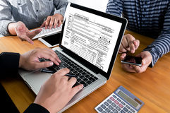 stock image of  time for taxes planning money financial accounting taxation businessman tax economy refund money
