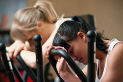 stock image of  tired women in gym