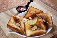 stock image of  ulund dal ka tasty toast, ulundu tasty toast, white gram tasty toast