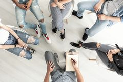 stock image of  top view of a group therapy session for teenagers struggling wit