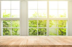 stock image of  top of wood table counter on blur window view garden background.