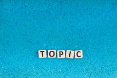 stock image of  topic word on stone