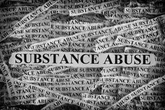 stock image of  torn pieces of paper with the words substance abuse