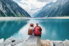 stock image of  travelers couple look at the mountain lake. travel and active life concept with team.