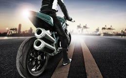 stock image of  traveling man riding big motorcycle on urban road