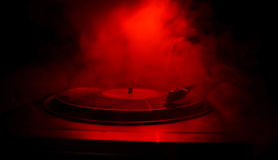 stock image of  turntable vinyl record player. retro audio equipment for disc jockey. sound technology for dj to mix & play music. vinyl record be