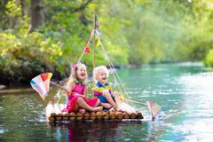 stock image of  kids on wooden raft