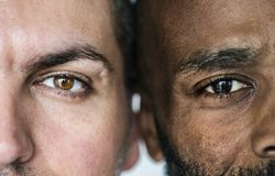 stock image of  two different ethnic men`s eyes closeup