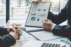 stock image of  two executive discussing company growth project success financial statistics, partner meeting professional investor working start