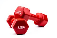 stock image of  two red dumbbells isolated on white background with copy space for text. 3.0 kg dumbbell. weight training equipment. bodybuilding
