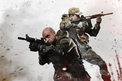 stock image of  two special forces soldiers men take aim on machine gun