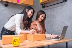 stock image of  two young asian people startup small business entrepreneur sme d