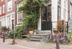 stock image of  typical amsterdam old city street view with traditional buildings and vintage bicycle