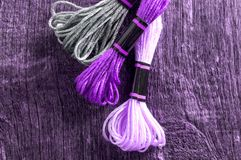 stock image of  ultra violet color of 2018. accessories for hobbies: different colors of thread for embroidery