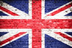 stock image of  united kingdom uk flag painted on a brick wall. concept image for great britain, british, england, english language, people